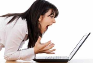 Woman Frustrated at Laptop