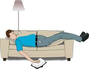 man on couch napping