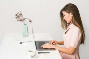 Lady on Laptop, standing