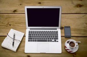Macbook air on wood table