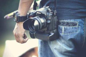 Nikon Camera on back of guy