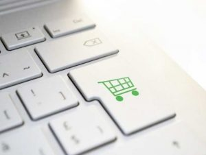Keyboard with Online Shopping Cart Icon on Return Button