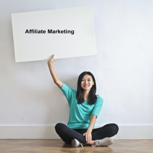 "Asian Lady holding ""affiliate marketing"" sign with right hand up"